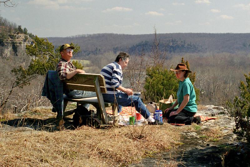 George, Norma and Rita picnic on the cliffs at Rock Eddy Bluff B&B near Rolla, Missouri. Spring, 2001.