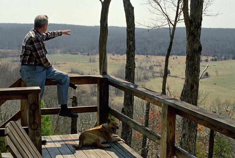 George, with a dog on the deck,  Rock Eddy Bluff B&B near Rolla, Missouri. Spring, 2001.