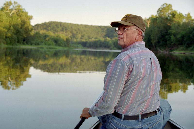 George paddling bow, Gasconade River near Rock Eddy Bluff. late summer 2002.