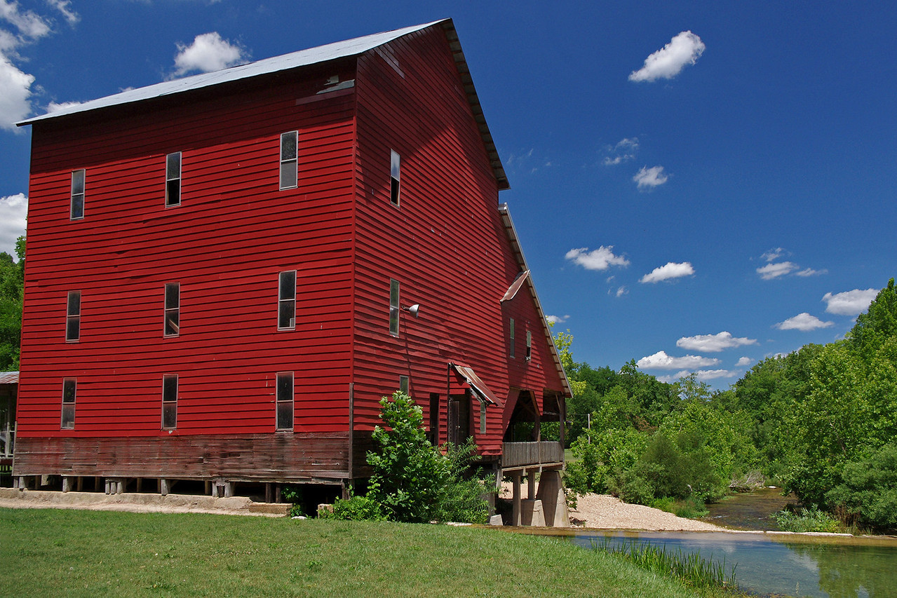 Mill at the Rainbow Trout Ranch; Rockbridge, Missouri, was built in 1868. Here, looking down Spring Creek, a tributary of Bryant Creek. After years of disuse, it presently houses a bar, The Rockbridge Grist Mill Club.