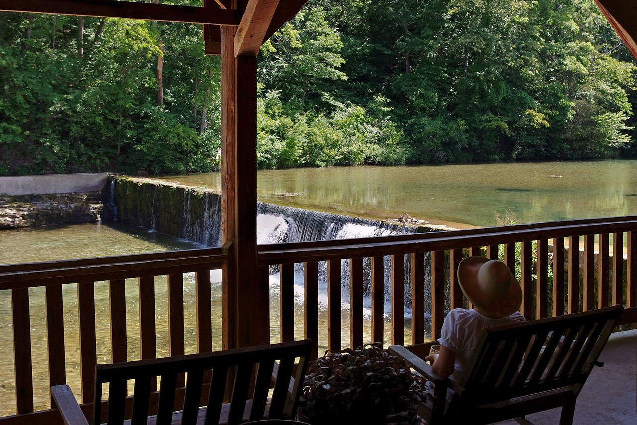 Mill interior, Rainbow Trout Ranch; Rockbridge, Missouri. Rita is sitting in the Rockbridge Grist Mill Club looking out over the mill dam on Spring Creek, a tributary of Bryant Creek.