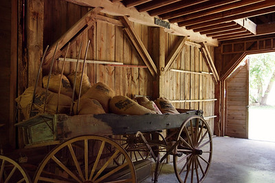 Mill interior at the Rainbow Trout Ranch; Rockbridge, Missouri - old wagon.  After years of disuse, the mill presently houses a bar, The Rockbridge Grist Mill Club.