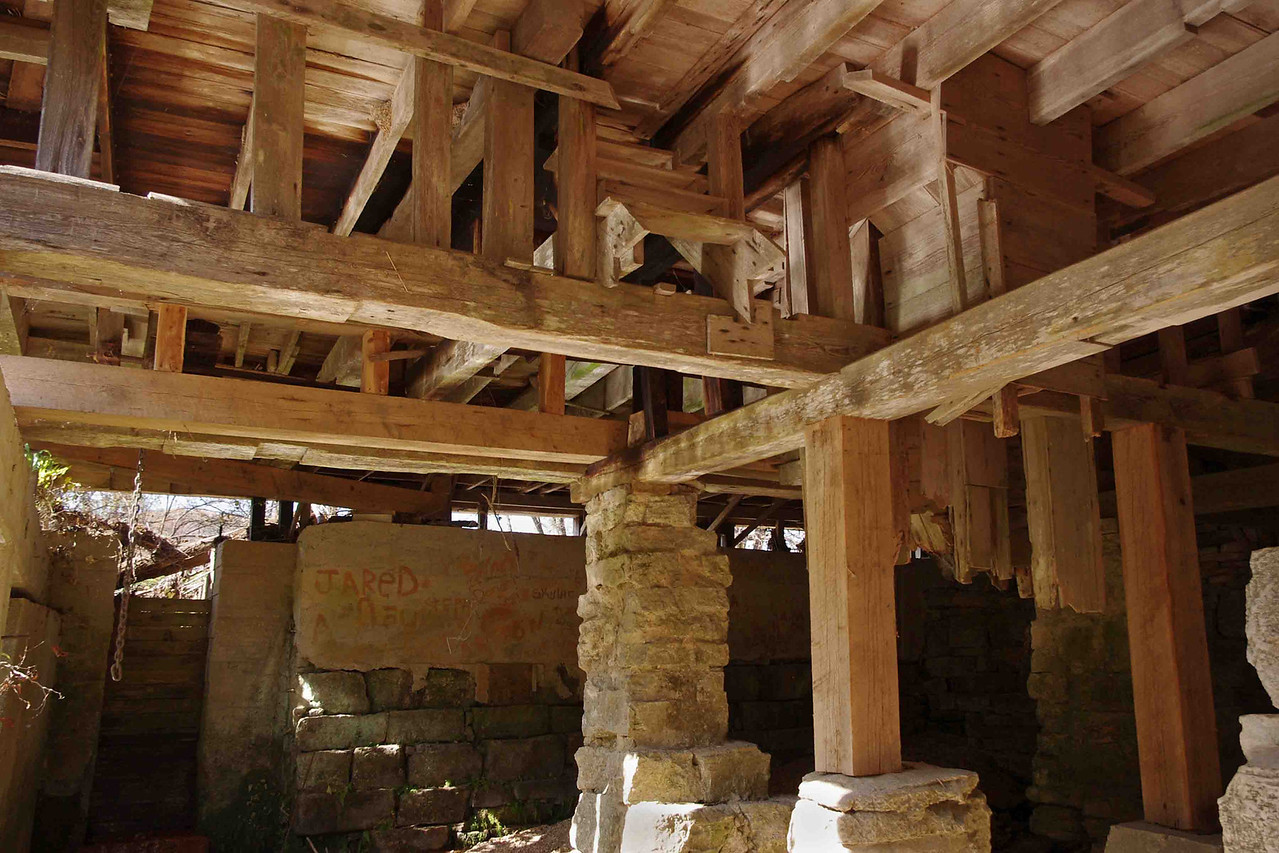 Underneath the old red grist mill on Spring Creek at Rockbridge, Missouri. Built in 1868, now part of the Rainbow Trout & Game Ranch.