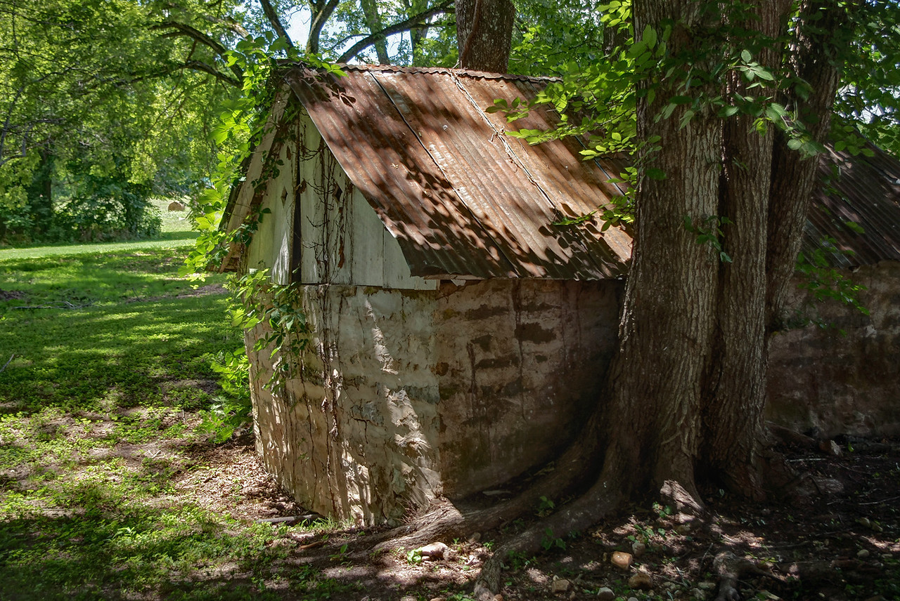 Old stone shed with metal roof; Rainbow Trout Ranch; Rockbridge, Missouri.