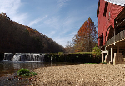 Old red grist mill on Spring Creek at Rockbridge, Missouri. Built in 1868, now part of the Rainbow Trout & Game Ranch.