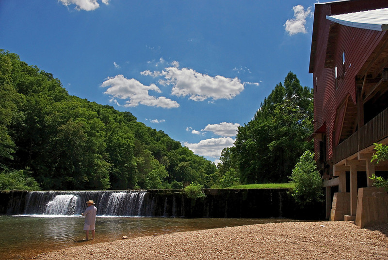 Fly fisherman below the mill dam, on Spring Creek. Rainbow Trout Ranch; Rockbridge, Missouri.