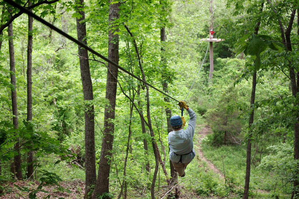 Rita, zipping through the canopy. Ziplines USA, near Reeds Spring, Missouri. Friday the 13th, May, 2011.
