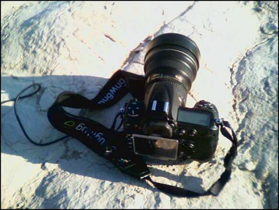 Picture of my Nikon D300 sitting on dry mud flat in the Mesquite Sand Dunes.  Taken with the camera on my Samsung cell phone during a break in photographing the sand dunes.