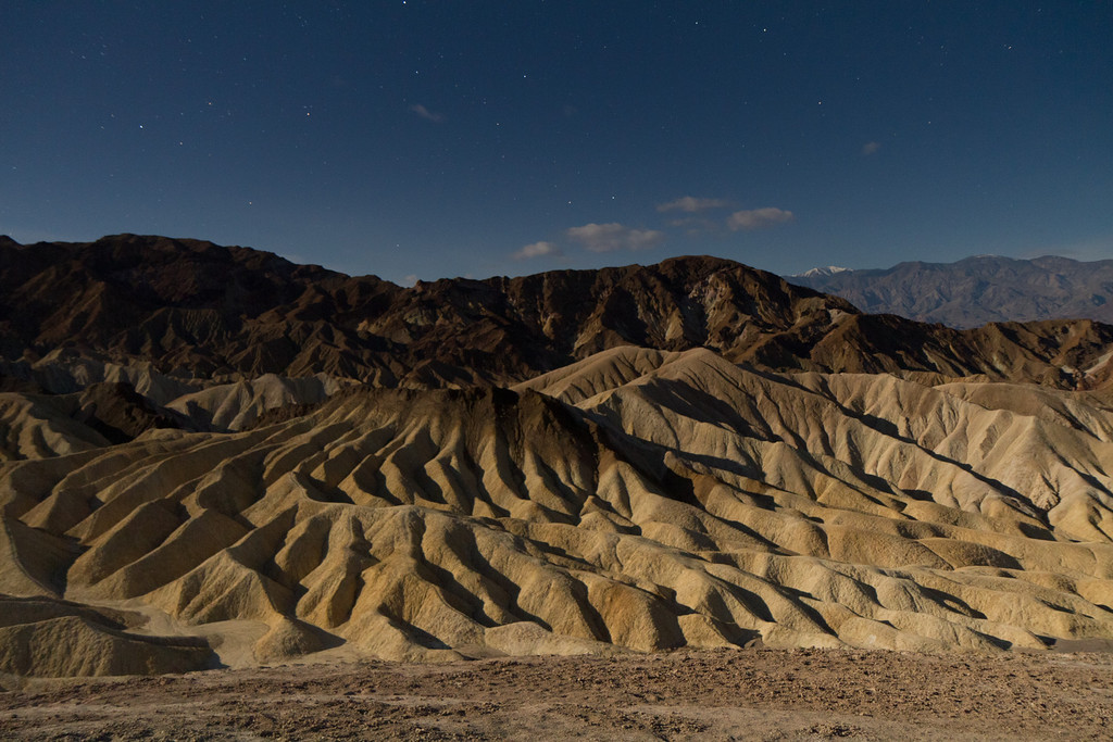 Arriving at Death Valley after sunset, this view from Zabriskie point is illuminated by the largest and closest full moon in 20 years.
