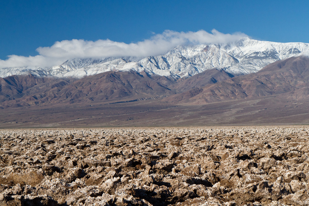 The Devil's Golf Course is a flat salt and dirt pan, eroded into small knobs of salt crystals. In the background are the Panamint mountains.