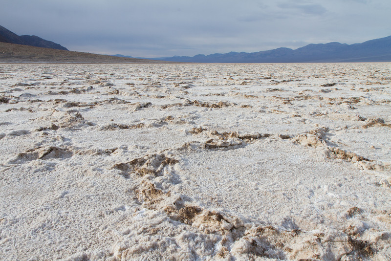 The Badwater basin is coated with thick collections of salts and mud.