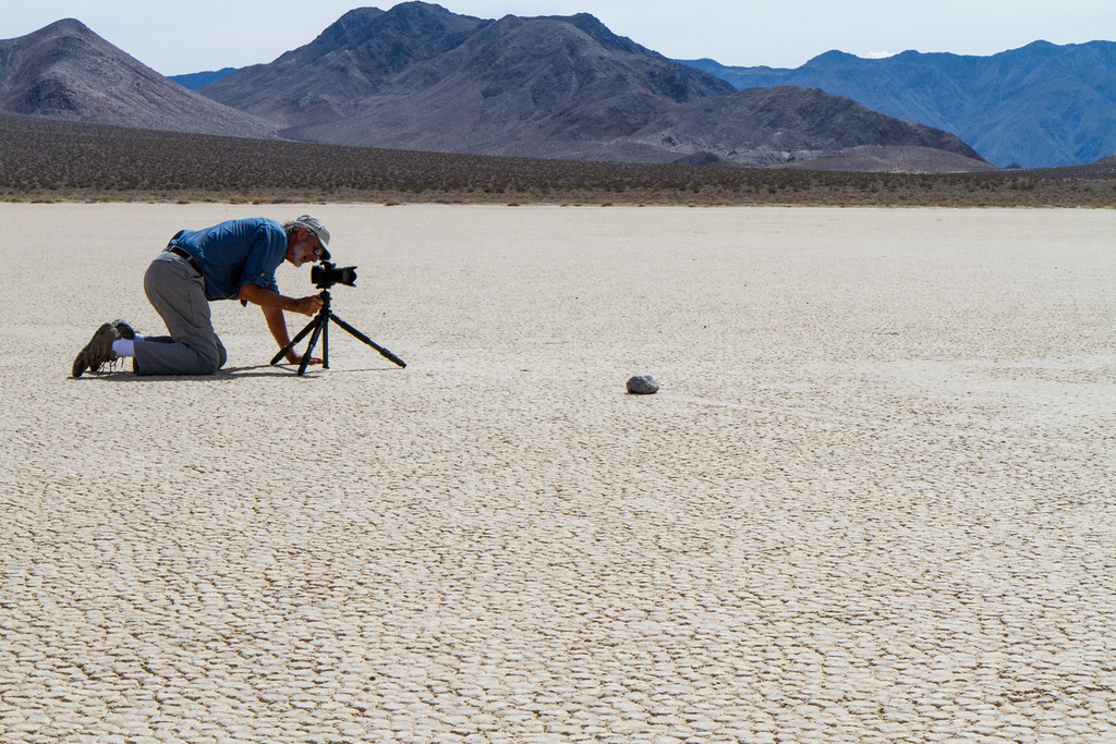 On the Racetrack- an ancient lake bed 2 by 3 miles across and one of the flattest surfaces on earth. On this flat surface (known as a Playa) rocks, some weighing hundreds of pounds, have moved leaving a trail behind them as evidence of their movement. Here one rock creeps up on Ken