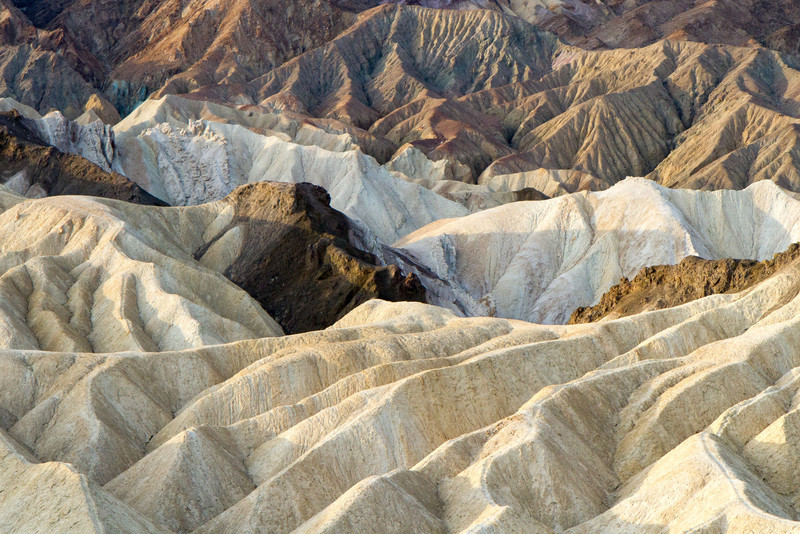 Badlands just south of Zabriskie point show some of the different types of earth and their different erosion patterns