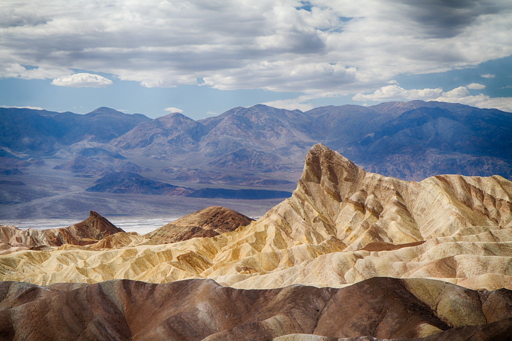 From Zabriskie point, late afternoon light between clouds shows of Manly Beacon, one of the highest point in the badlands below