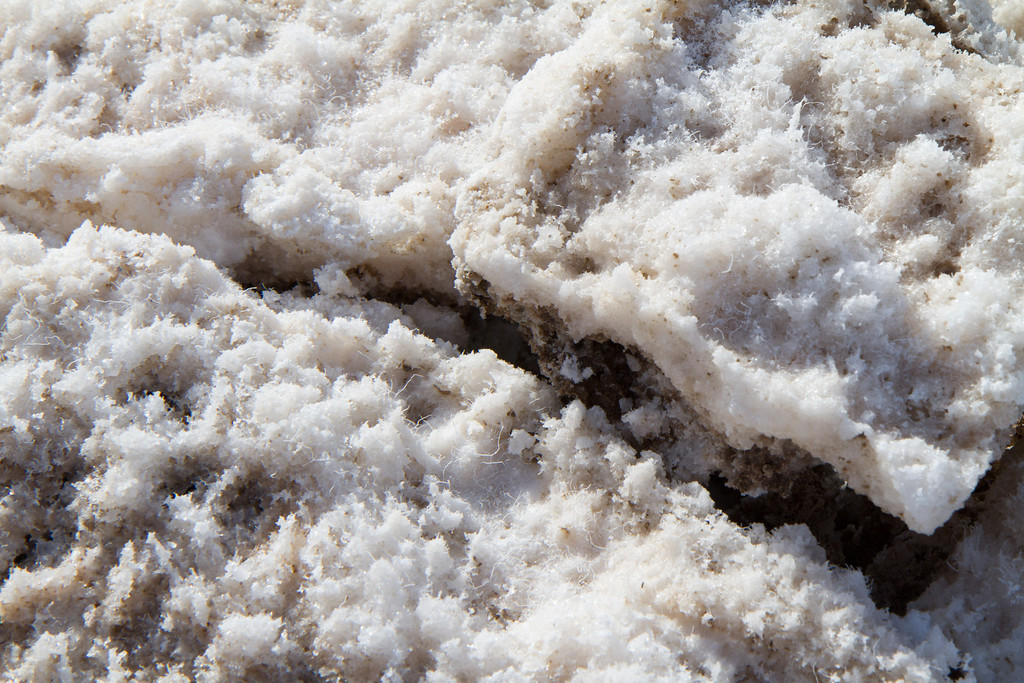 The salt can be as sharp and hard as a razor, sharp enough to hurt. However up close is this world of delicate salt crystals.