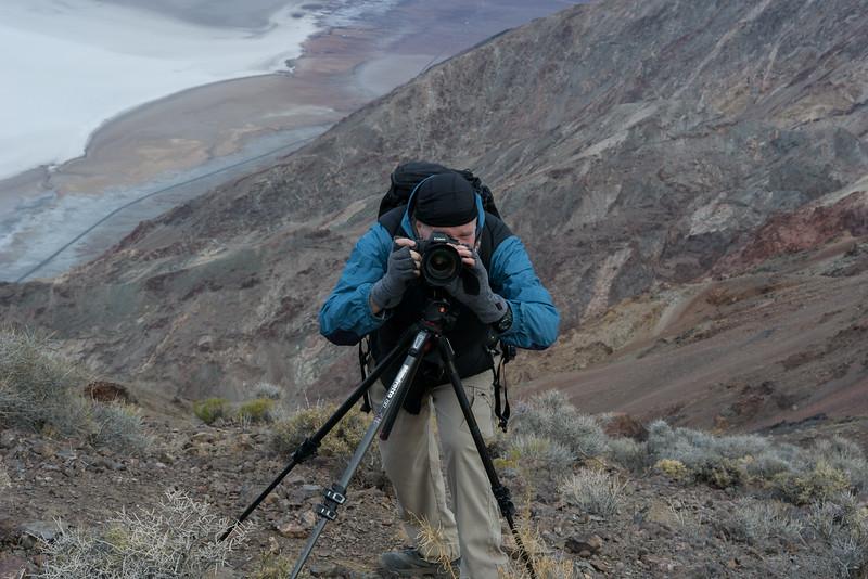 John Linder, dueling cameras. What looks like water 5476 feet below is salt.