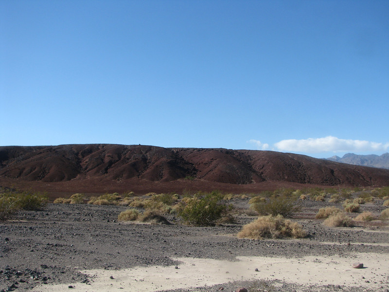 Red hill among ground of gray ground.