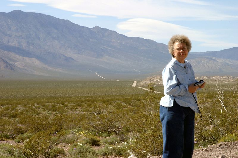 "<font size=""+1"">This is my favorite picture of Mom.  I so wish I'd remembered my UV haze filters..  Anyway, if you look at the road in the back ground, we got the flat just at the tip of the last rise clear across the valley floor.</font>"