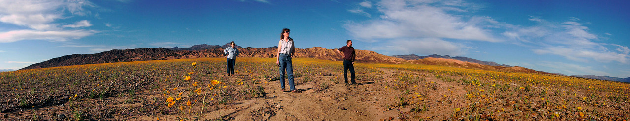 "<font size=""+1"">Here we are again in ""assemble-a-photo"" land.  This is a stitched panorama of the point where the tiny little road from the north finally hits the ""main highway"".  This is composed of 11 photos and really, we weren't all standing out there together like this, neither were we alone, though it DID come out pretty cool, didn't it?  We can REMEMBER that we were all there.</font>"
