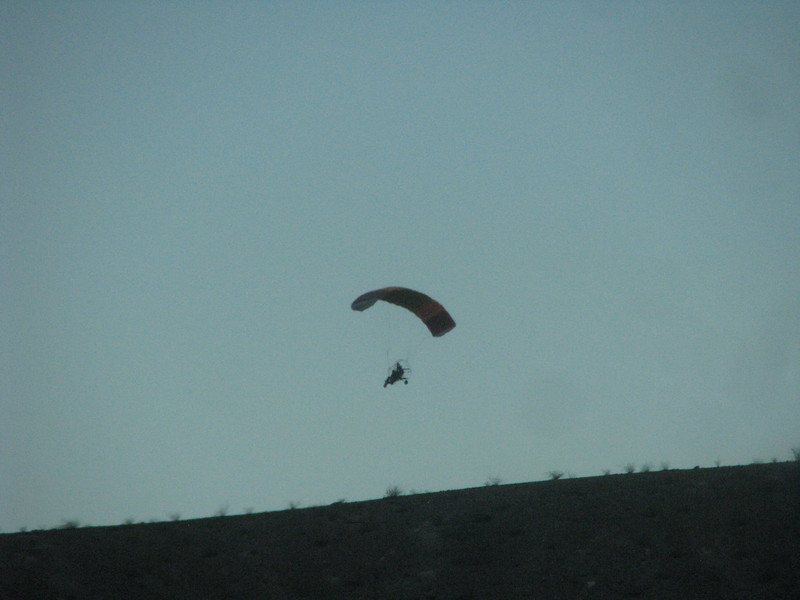 Julie captured this photo of a high flying man using a motor parachute.