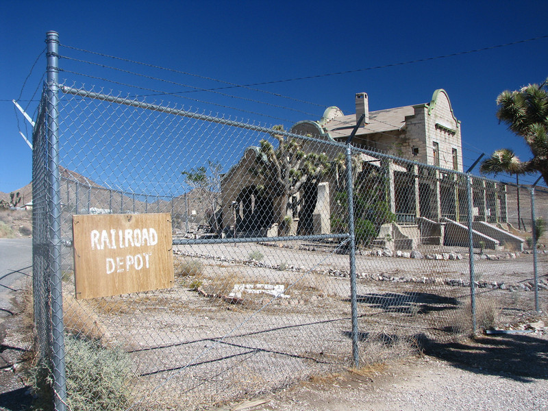 Rhyolite train station,its a shame that it behind a chainlink fence. this to protect the public and keep griffi dogs from leaving their mark that is on many of the other ruins.