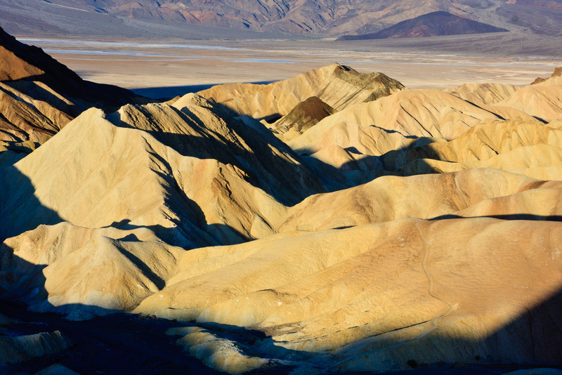 Sunrise at Zabriskie Point. Sharp shadows and golden light.