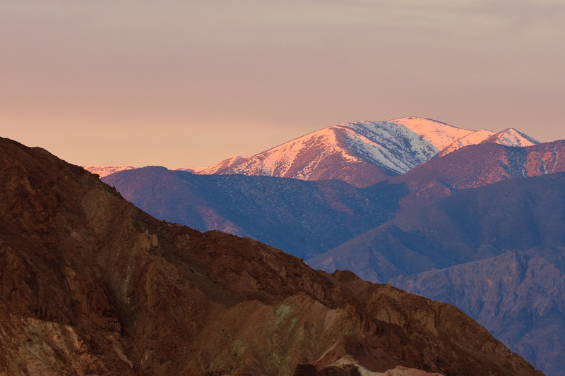 Sunrise at Zabriskie Point. The sun touches Telescope Peak.