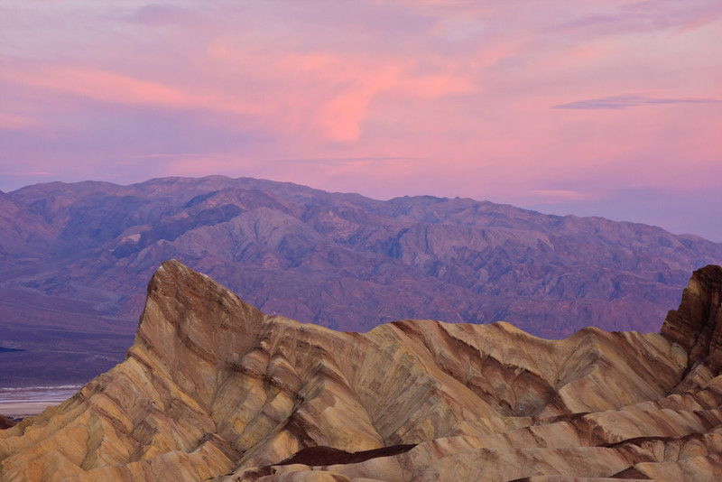 Sunrise at Zabriskie Point. Looking past Manly Beacon across the valley.