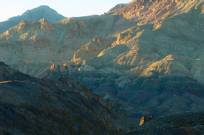 Titus Canyon at sunset, mist, and a touch of light on the hills.