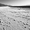 """<span id=""""title"""">Salt Flats</span> <em>West Side Road</em> Near the northern end of West Side Road, it crosses salt flats that run like a river through the Devil's Golf Course. It was crazy to see the salt and the salt/mud formations right next to each other."""