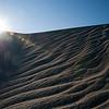 "<span id=""title"">Sunburst</span> <em>Mesquite Flats Dunes</em> Taking advantage of the sun peeking over one of the dunes."