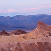 "<span id=""title"">Manly Beacon</span> <em>Zabriskie Point</em> This is the more typical view of Zabriskie Point. The promotory is called Manly Beacon. It's named for a guy whose last name was Manly, not because of its masculine features. I took this photo a minute or two after the 'peak colorfulness' that occurs during sunrise."