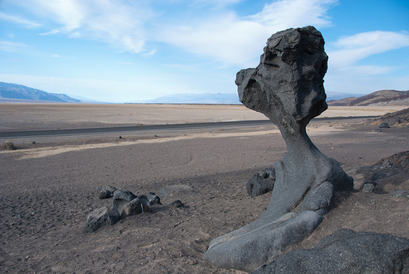 """<span id=""""title"""">Mushroom Rock</span> <em>Badwater Road</em> Perhaps in an attempt to preserve it, this rock is not advertised. There's a parking pull-off, but no sign, no explanation and it doesn't appear on any of our maps. It's pretty awesome though - it's just a few inches thick at it's thinnest part."""