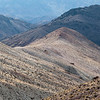 "<span id=""title"">Dante's View</span> <em>Dante's View</em> Dante's View is a vista that overlooks Death Valley and specifically the salt flats at Badwater. This is looking away from Death Valley, to the East, but I like how the light was hitting the side of the hill."