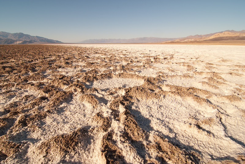 """<span id=""""title"""">Transition</span> <em>West Side Road</em> I tried to capture the transition between the muddy formations and the pure white salt flats. It was pretty cool."""