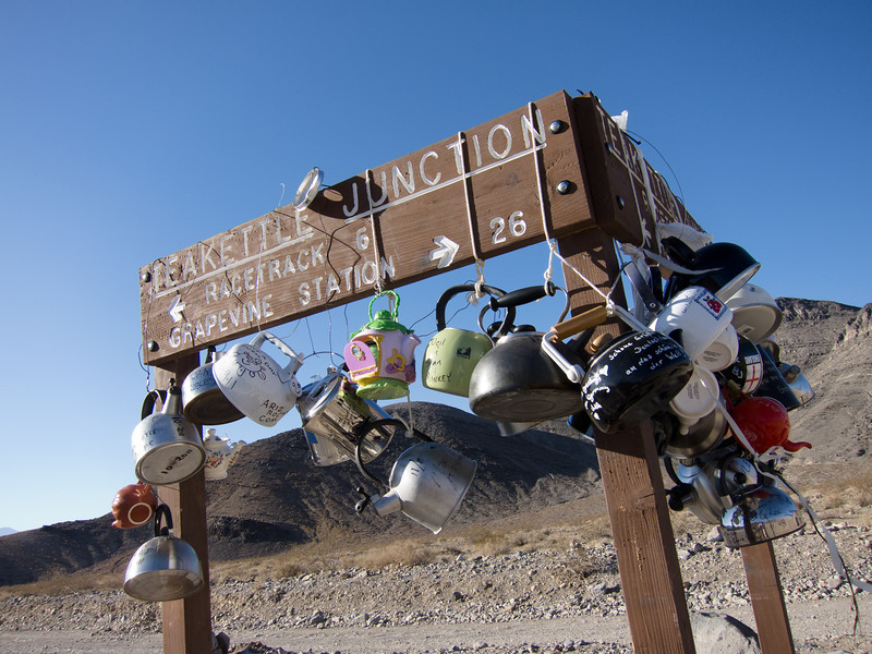 """<span id=""""title"""">Teakettle Junction</span> <em>Racetrack Road</em> I knew about this sign before we came to Death Valley, so I should have brought our own kettle to hang on it. What a fun thing."""