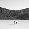 "<span id=""title"">Lost Boys</span> <em>Racetrack Playa</em> I thought this was cute. These two boys are walking across the Racetrack playa towards the Grandstand. But, you can imagine them heading off on their own adventure, like in some coming-of-age movie."