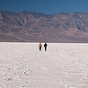 "<span id=""title"">Long Journey</span> <em>Badwater Basin</em> Don't worry, this couple didn't go much farther. It wasn't hard to walk on (unlike the Devil's Golf Course), but the salt flats are so incredibly vast that I'm not sure how far you could get. You know what would be fun? Mountain biking across them. Of course that's not allowed, but it would be fun."