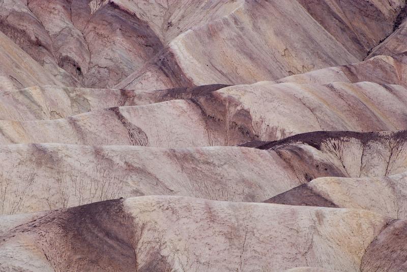 "<span id=""title"">Lines in the Dirt</span> <em>Zabriskie Point</em> A detail view of the badlands near Zabriskie Point."