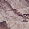 "<span id=""title"">Lines in the Dirt</span> <em>Zabriskie Point</em> A detail view of the badlands near Zabriskie Point."