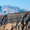 "<span id=""title"">Crater Wall</span> <em>Ubehebe Crater</em> This dramatic erosion is the edge of the Ubehebe Crater, which you <em>have</em> to drive past if you're coming back from the Racetrack. It's a volcanic crater that exploded a couple thousand years ago. It's very impressive and it's neat that you can hike to the bottom of it. After a long day, we turned down that opportunity."