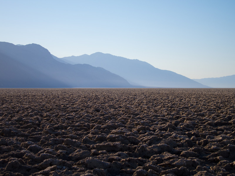 """<span id=""""title"""">Devil's Golf Course</span> <em>Devil's Golf Course</em> A view of the Amargosa mountains reaching into Death Valley."""