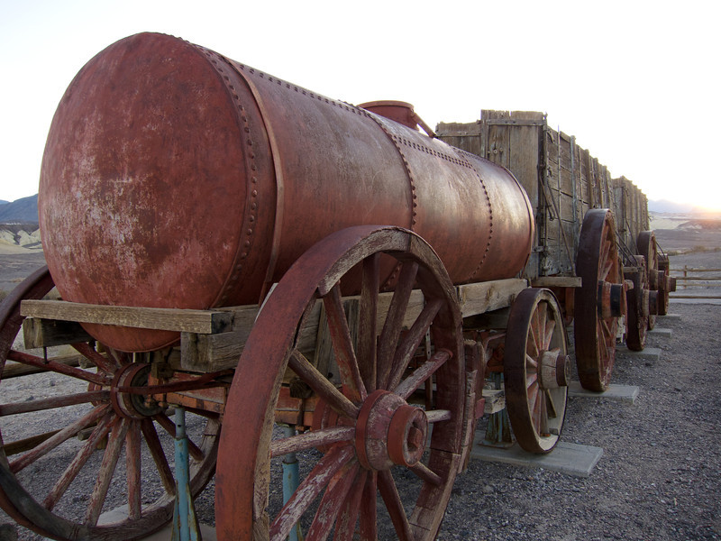 """<span id=""""title"""">Twenty Mule Wagon Train</span> <em>Harmony Borax Works</em> When borax was first mined in the late 1800s, it was all hauled out on mule trains like this. Apparently the train didn't have to have exactly 20 mules, but that was typical. I assume this tank at the front (or back?) was for water."""