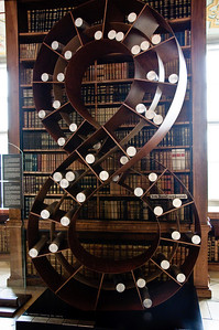 An old library shelf to hold rolled up manuscripts. The infinity symbol...
