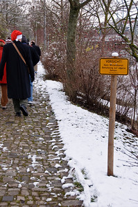 The sign is warning us not to walk on these cobblestones in snow....