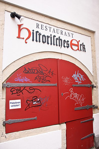 Graffiti on the door of the Historical Corner Restaurant.