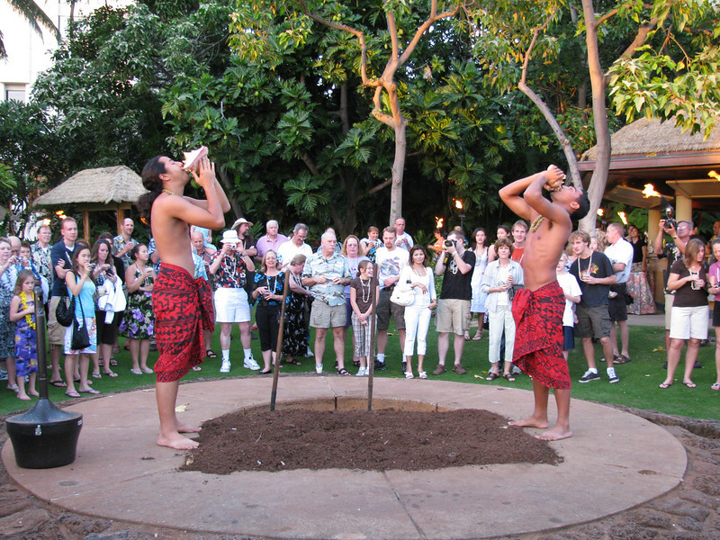 12/22 - Hale Koa luau<br /> Luau boys about to dig out our pig for dinner