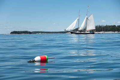 20150722.  Schooner sailing westward just north of Mark Island in East Penobscot Bay, ME; about 1.4 miles southeast of Deer Isle, ME.  Andrew Island is in background.