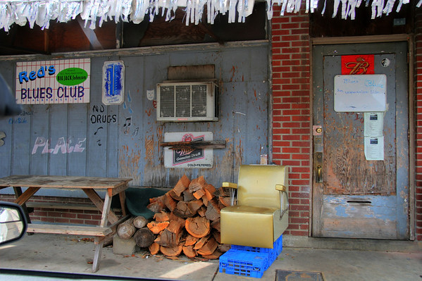 Reds Juke Joint. Scary on the outside, clearly Blue on the inside. Clarksdale Mississippi. Love the salon chair propped up on bread crates