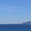 This is all you could see from Pt Dume.  Pt Mugu is around the point in the distance.  The zig-zag contrail is all that was visible.  The vehicle did fly about 90 degrees in azimuth to the left and about 50 degrees in elevation at the end.  But here you see that the contrail ended just a few degrees above the horizon.